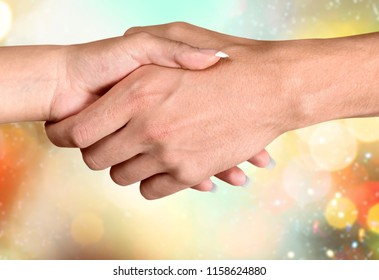 Old and Young Hand on blurred background