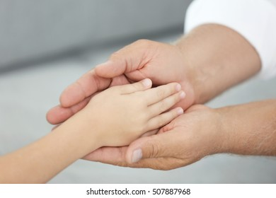 Old and young hands, closeup
