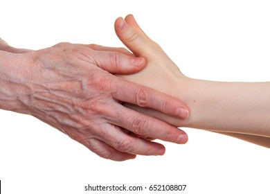 Old and young holding hands of each other, isolated on a white background.