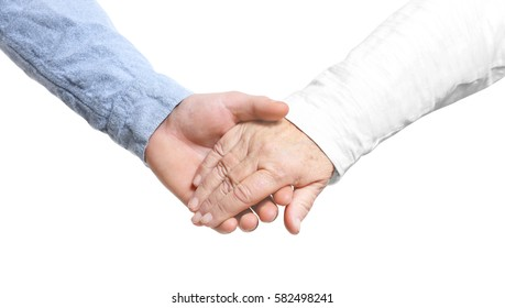 Old and young holding hands on white background
