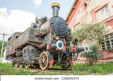 Old Yugoslavian locomotive near old railroad station in city of Vrsac Serbia East Europe