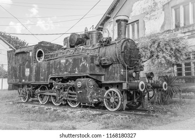 Old Yugoslavian train near old rail station in the city of Vrsac Serbia East Europe, black and white