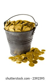 Old zinc bucket with golden coins. Isolated.