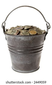 Old zinc bucket with silver coins. Isolated.