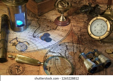 Old Zodiac globe,astrological.Vintage map,old coins.Retro ship lantern,binoculars,sextant.Antique compass.Candlestick,watch and magnifier Travel and marine engraving background. Treasure hood concept.