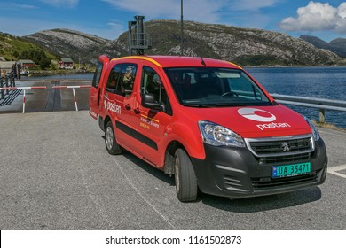 Oldeide, Norway, July 25, 2018: Norwegian mail van is parked next to ferry docking as its operator waits for the ferry to deposit mail onboard.