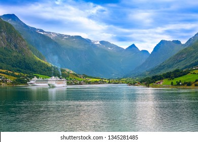 Olden, Norway - August 1, 2018: Norwegian fjord landscape and cruise ships in the port