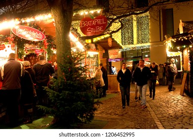 "Oldenburg, Germany - December 11, 2011: street scene at the christmas market ""Lamberti Markt"" at night with some huts and beautiful christmas lights"