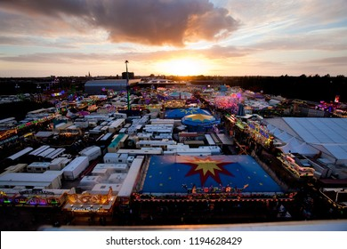 "Oldenburg, Germany - October 03, 2018: aerial overview of the fairground ""Kramermarkt"" while a beautiful sunset"
