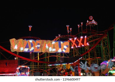 "Oldenburg, Lower Saxony, Germany - Circa October 2018: Rollercoaster ""Wilde Maus"" at night, seen at the funfair ""Kramermarkt"""