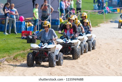 OLDENZAAL NETHERLANDS - APRIL 9, 2017: Unknown people waiting for the start sign on their mini quads during a demonstration