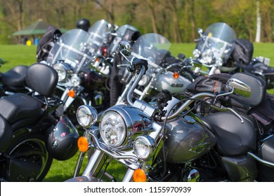 OLDENZAAL NETHERLANDS - APRIL 9, 2017: several identical Harley Davidson motorbikes parked on the grass during an event
