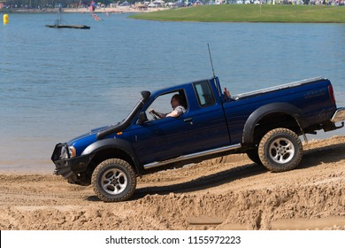 OLDENZAAL NETHERLANDS - APRIL 9, 2017: People having fun in an offroad car during an annual event