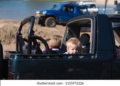 OLDENZAAL NETHERLANDS - APRIL 9, 2017: Unknown kids in an open backseat of an offroad car during an annual event