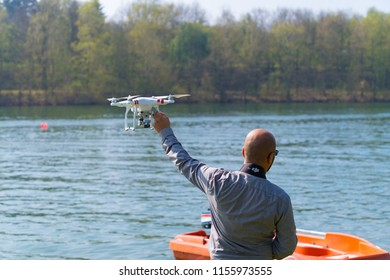OLDENZAAL NETHERLANDS - APRIL 9, 2017: Unknown man holding his drone high before taking off