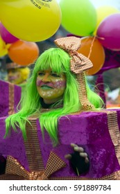 OLDENZAAL, NETHERLANDS - FEBRUARY 26, 2017. Woman with green wig walking in the carnival parade.