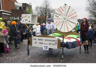 OLDENZAAL, NETHERLANDS - FEBRUARY 26, 2017. Couple with bed on wheels during Carnival parade.