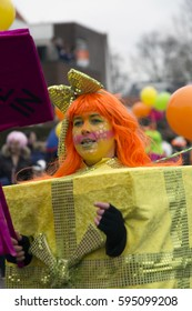 OLDENZAAL, NETHERLANDS - FEBRUARY 26, 2017. Woman in yellow gift box during Carnival parade.