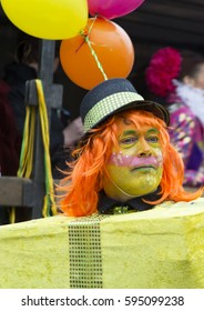 OLDENZAAL, NETHERLANDS - FEBRUARY 26, 2017. Man as a yellow gift box during Carnival parade.