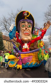 OLDENZAAL, NETHERLANDS - FEBRUARY 7, 2016: Unknown people joining the annual carnival parade with a decorated wagon