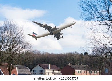 OLDENZAAL, NETHERLANDS - JANUARY 19, 2018: Air France passenger airplane just above a residential area