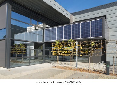 OLDENZAAL, NETHERLANDS - OCTOBER 31, 2015: Solar panels above the entrance of a modern sustainable office building