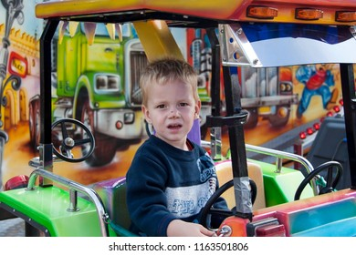 OLDENZAAL, OVERIJSSEL / NETHERLANDS - AUGUST 16 2006: Boy playing with car at fun fair.