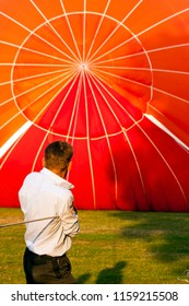 OLDENZAAL, OVERIJSSEL / NETHERLANDS - AUGUST 23 2013: Man helping air balloon with rope before flying at Ballooning Festival.