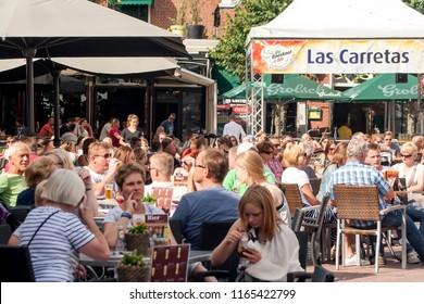 OLDENZAAL, OVERIJSSEL / NETHERLANDS - AUGUST 5 2015: Terrace with people.