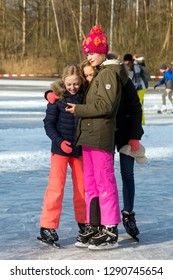 OLDENZAAL, TWENTE, OVERIJSSEL / NETHERLANDS – MARCH 2 2018: Three young girls making selfie with smartphone on ice skate ring at park Hulsbeek.