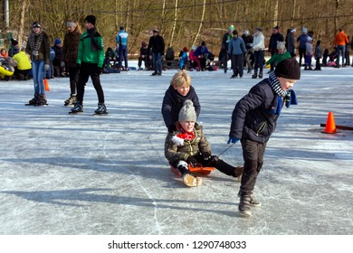 OLDENZAAL, TWENTE, OVERIJSSEL / NETHERLANDS – MARCH 2 2018: A lot of people on ice skate ring at park Hulsbeek.