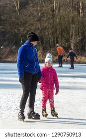 OLDENZAAL, TWENTE, OVERIJSSEL / NETHERLANDS – MARCH 2 2018: Woman with young girl at ice skating on park Hulsbeek.