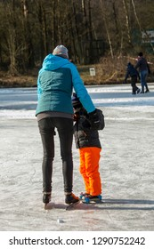 OLDENZAAL, TWENTE, OVERIJSSEL / NETHERLANDS – MARCH 2 2018: Mother learning child ice skating at park Hulsbeek.