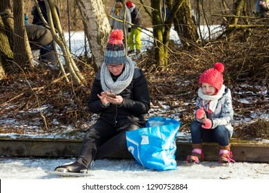 OLDENZAAL, TWENTE, OVERIJSSEL / NETHERLANDS – MARCH 2 2018: Family break on nature boarding at ice skate ring on park Hulsbeek.