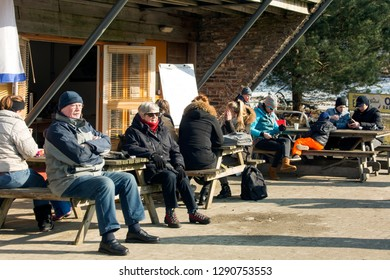 OLDENZAAL, TWENTE, OVERIJSSEL / NETHERLANDS – MARCH 2 2018: Terrace with people to take a break and enjoy some food and hot drinks.