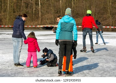 OLDENZAAL, TWENTE, OVERIJSSEL / NETHERLANDS – MARCH 2 2018: Group people at ice skating on park Hulsbeek.