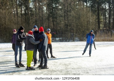 OLDENZAAL, TWENTE, OVERIJSSEL / NETHERLANDS – MARCH 2 2018: Group people on ice skate ring at park Hulsbeek.