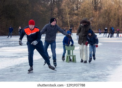 OLDENZAAL, TWENTE, OVERIJSSEL / NETHERLANDS – MARCH 2 2018: Ice skating people on frozen lake at park Hulsbeek.