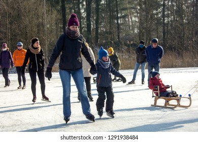 OLDENZAAL, TWENTE, OVERIJSSEL / NETHERLANDS – MARCH 2 2018: Group people are ice skating at park Hulsbeek.