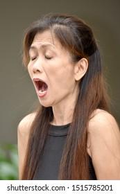 An Older Asian Female Senior Yelling