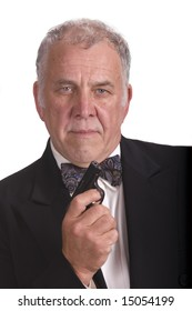 older businessman with gun - james bond impersonation LOL, isolated over white