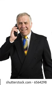older businessman on the phone in anguish, isolated on white