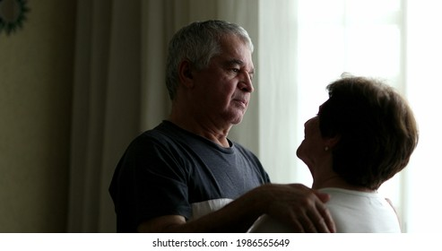 Older couple embrace, senior emocional intimacy. middle aged husband hugging and caring for wife