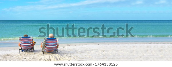 An Older Couple Enjoying the Day Together on the Beach