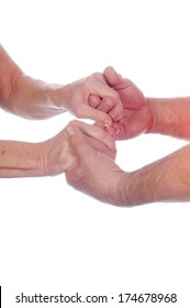 Older couple holding hands as a sign of affection or love isolated on white