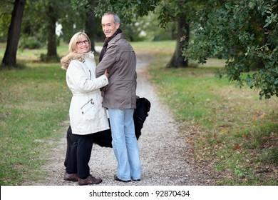 Older couple strolling through a park