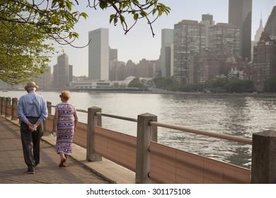 older couple walking along park path