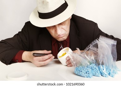 Older dealer of mdma narcotics counting and checking lot of pills