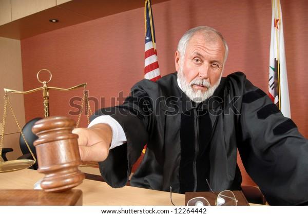 Older, distinguished judge making his ruling in the courtroom