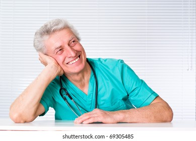 older doctor with tethoscope on a white background